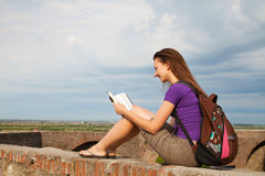 Teen girl reading the Bible Stock Image