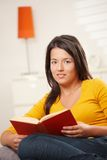 Teen girl reading book Stock Photo