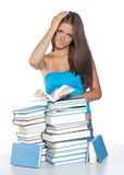 Teen girl reading book. Attractive worried teen with open book making expression Royalty Free Stock Photography
