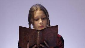 Teen girl reading book. 4K UHD stock video footage