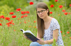 Teen girl reading book Stock Image