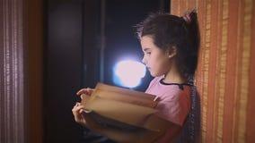 Teen girl reading book is wall education indoor stock footage