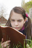Teen girl reads book Royalty Free Stock Photo