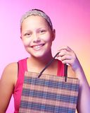 Teen girl receives a gift. Beautiful happy teen girl receives a gift on a birthday Royalty Free Stock Photography