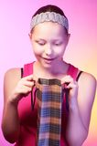 Teen girl receives a gift. Beautiful happy teen girl receives a gift on a birthday Stock Photography