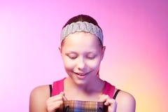 Teen girl receives a gift. Beautiful happy teen girl receives a gift on a birthday Stock Photos