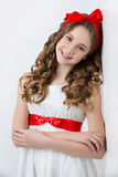 Teen girl with red bow on head Stock Photos