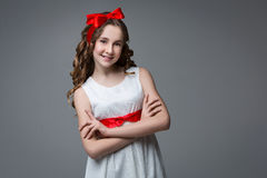 Teen girl with red bow on head Royalty Free Stock Image