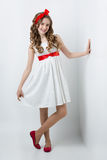 Teen girl with red bow on head Stock Images