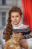 Teen girl with a red cat Stock Photo