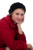 Teen girl in red coat and black Royalty Free Stock Image