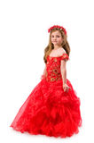 Teen girl in a red dress Royalty Free Stock Image