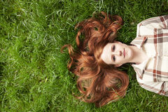 Teen girl with red hair looking at sky Stock Photography