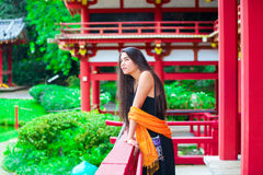Teen girl  at a red Japanese or Chinese Bhuddist temple Royalty Free Stock Image