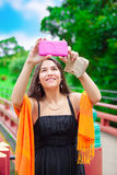 Teen girl  at a red Japanese or Chinese Bhuddist temple Royalty Free Stock Images
