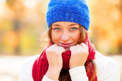 Teen girl in red scarf Stock Images