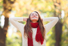 Teen girl in red scarf Royalty Free Stock Photos