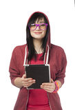 Teen girl in red with tablet  at white background. Royalty Free Stock Photos