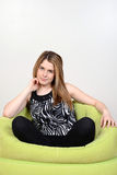 Teen girl relaxing in bean bag chair Stock Photos