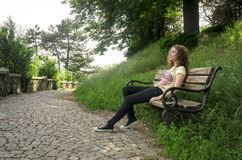 Teen girl relaxing on a bench Stock Photography