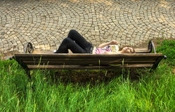 Teen girl relaxing on a bench Stock Photo
