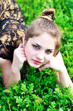 Teen girl relaxing in the grass. Tender fashion teen girl relaxing in the grass on the meadow Royalty Free Stock Photos