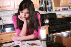 Teen girl relaxing in kitchen Royalty Free Stock Photos