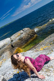 Teen girl relaxing on a sea coast Stock Photo