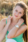 Teen girl resting in a field Royalty Free Stock Images
