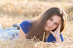 Teen girl resting in a field Stock Photos