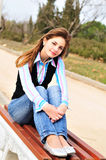 Teen girl resting in the park Royalty Free Stock Image
