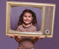 Teen girl retro child framed television frame smiling on gray ba. Ckground Stock Photos