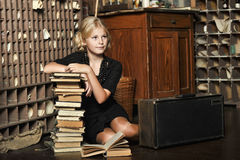 Teen girl  in retro style with a stack of books Stock Photos