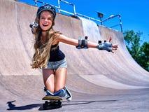 Teen girl rides his skateboard Stock Photography