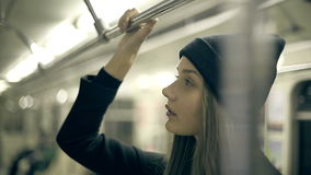 Teen girl rides the metro at night stock video footage