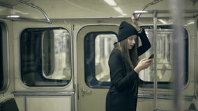 Teen girl rides the metro at night and used smartphone stock video footage