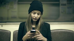 Teen girl rides the metro at night and used smartphone. Teen girl rides the subway at night and used smartphone stock video footage