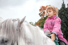 Teen girl riding horse Royalty Free Stock Photography