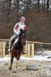 Teen girl riding a horse Stock Images