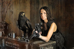 Teen girl  with a rifle. And eagle close Stock Photo