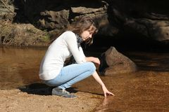 Teen girl at riverbank  Royalty Free Stock Photo