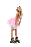 Teen girl in roller blades. Blond teen girl wearing inline roller blades isolated against white background Royalty Free Stock Photo