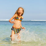 Teen girl running on the beach Royalty Free Stock Image