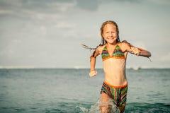 Teen girl running on the beach Royalty Free Stock Photo