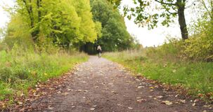 Teen girl running on park path hurry slide movement