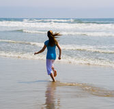 Teen Girl Running in the Surf Stock Photo