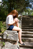 Teen Girl Sad. Sad young woman sitting on stairs outdoors and sad Royalty Free Stock Photography