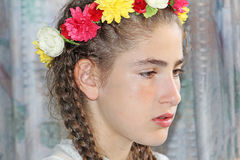 Teen girl with sad expression. And a crown bouquet of flowers on her head Stock Photos