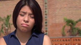 Teen Girl Sad Face. A young female hispanic teen Stock Photo