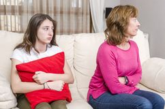 Teen girl is sad because her mother is angry at home. Teen girl is sad because her mother is angry at home stock image